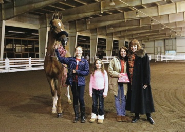 Horse presentations are a common part of barn holiday parties. In 2014, Sara Evans received CH Keeper Of The Stars at the High Caliber party.