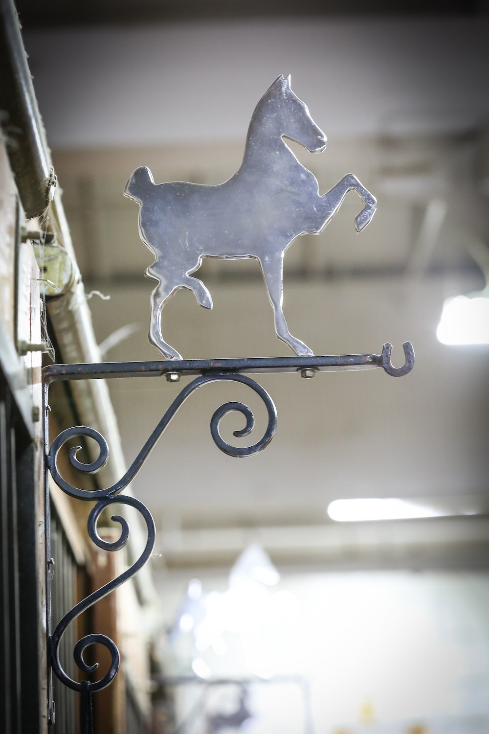 Barns can add a unique touch to their stabling areas with decorative pieces like this.