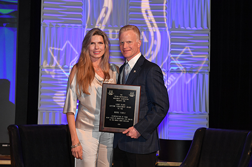 Melissa Moore accepted the Larry Bacon Lifetime Achievement Award on behalf of the Moore family. Photo by Howard Schatzberg.