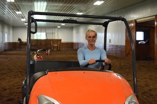 Elisabeth spends lots of time in the Kubota at Visser Stables, dragging the ring between horses.