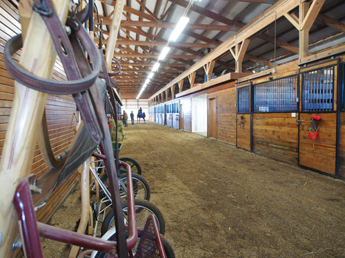 Mike Roberts Stable is built like one giant indoor arena, with a lounge, tack room and stalls in the center and down one long side.