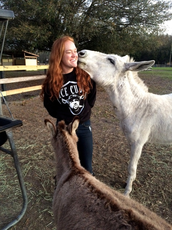 Ali spends some time with donkeys Sloopy and Schroder.