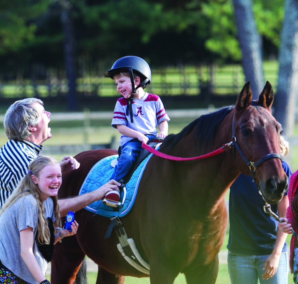 The intuitive nature of horses makes them well suited as therapy animals. At The Red Barn in Leeds, Alabama, they touch the lives of those with physical cognitive and emotional disabilities daily.