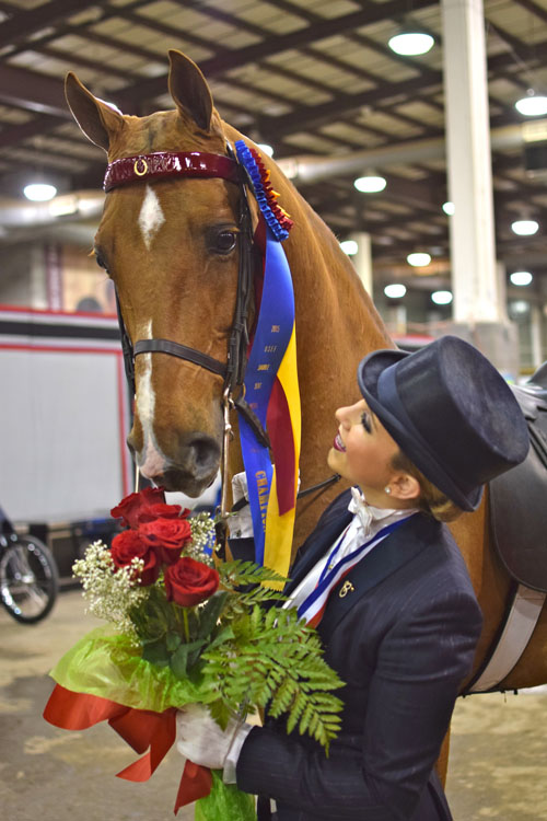 Cameron Kay clinched the final leg of the Equitation Triple Crown when she won the USEF Medal Finals with her partner Reedanns Heir To Glory becoming the first rider to win the Equitation Triple Crown in both the Saddlebred and Morgan worlds.