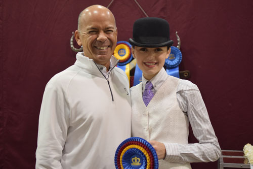 David Rudder congratulated his daughter Alex after she won the Junior Exhibitor Show Pleasure 14-17 Championship aboard Kalarama's Prospero.