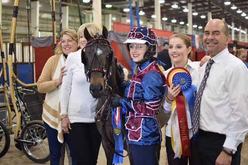 Emma Wood drove Sirfistication to the AHHS Youth Medallion Road Pony 14 17 Finals and celebrated with her Rowdy Lowrys crew
