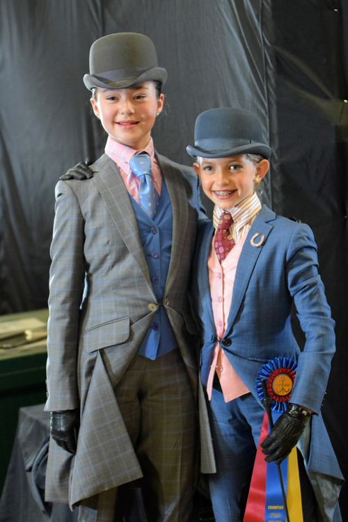Gracie Weissman and Kennedy Wisdom demonstrate good sportsmanship after the Walk/Trot Equitation Championship at Bridlespur.