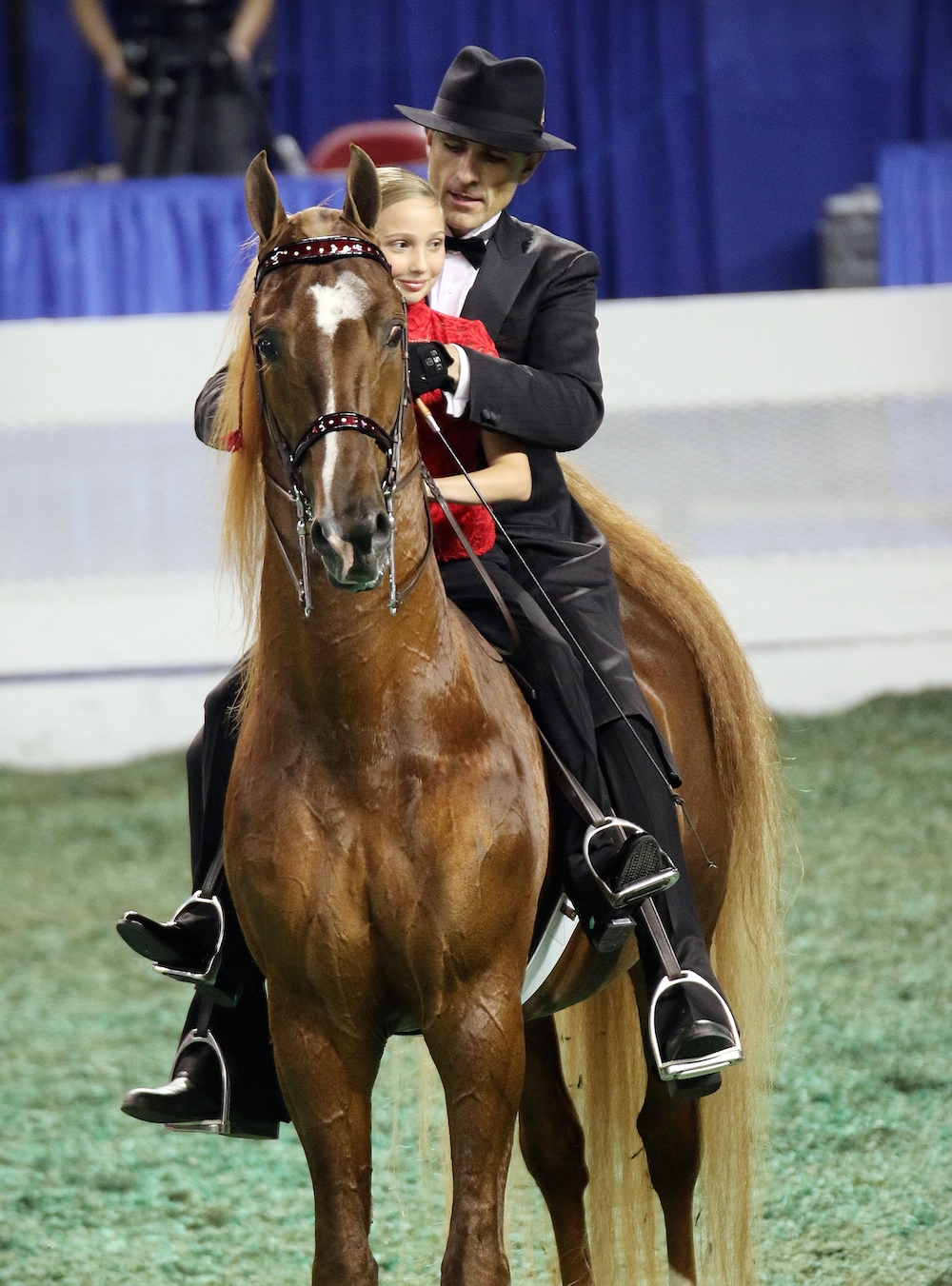 Marc during his retirement ceremony on Friday night of the World's Championship Horse Show, with Lionel and young fan Ella Herrin. Photo by Julia Shelburne-Hitti.